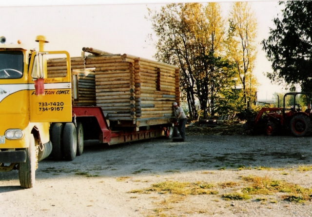 Cab-over hauling log cabin